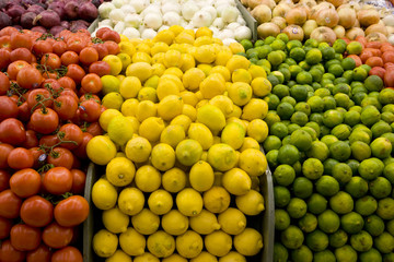 Close up of tomatoes, lemons and limes