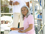 Senior woman on boat drinking white wine