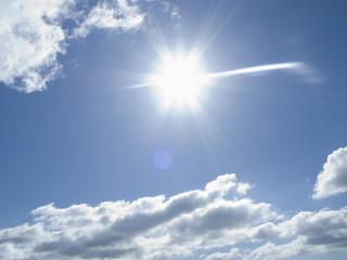 Blue sky, clouds, sun and sunbeams