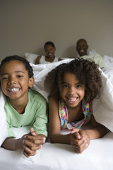 Family laying in bed