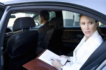 Businesswoman sitting in car