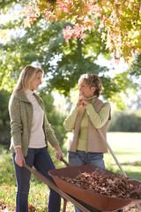 Women doing yard work in autumn