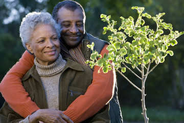 Senior couple admiring young tree
