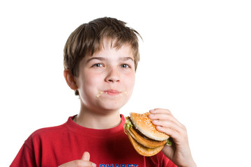 The boy eating a hamburger.