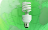 Compact fluorescent light bulb over planet background