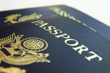 Closeup if American passports, on light background