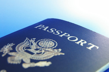 Closeup of U.S. passport, on blue background