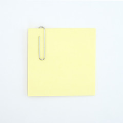 Sticky note and paperclip