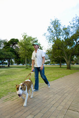 Man walking dog in park, low angle view