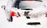 car after snowfall poster