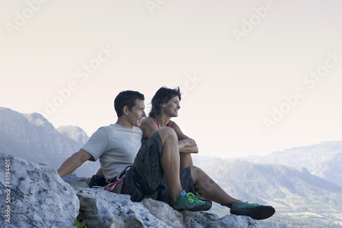 Two climbers resting at the top