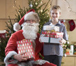 A grandfather dressed as Santa Claus with his grandson