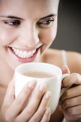 Woman drinking a mug of tea