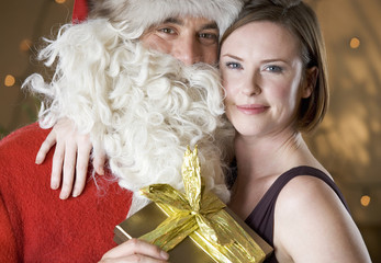 Father Christmas/Santa Claus giving a present to a mother