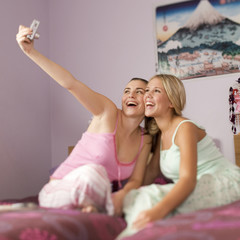 Two teenage girls in a bedroom