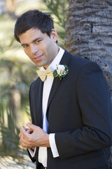 A groom holding the wedding ring
