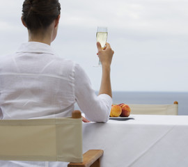 A woman drinking champagne alone