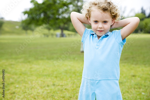 Little girl standing in the park