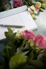 Order book and pen lying on the counter of a florist's shop