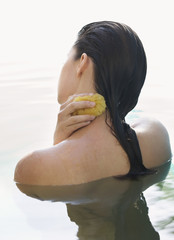 A woman washing with a sponge