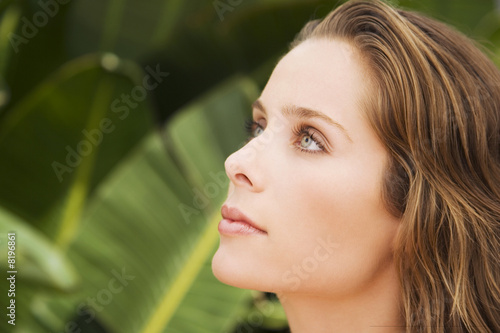 Portrait of a woman in a tropical setting