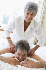 Man receiving a massage from a woman