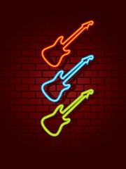Neon guitars on brick wall