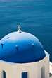 Cycladic church dome overlooking the Aegean sea