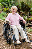 Senior Woman In Wheelchair Outdoors poster