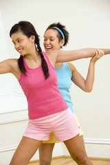 Smiling women doing yoga