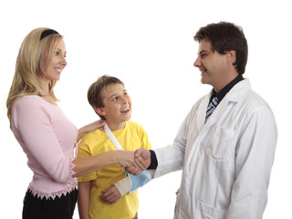 Parent thanking doctor after child medical treatment