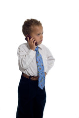 Young boy dressed as businessman talks on the mobile phone - iso