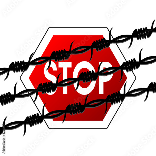Barbed wire lines crossed over stop sign