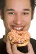 Eating Sprinkled Donut