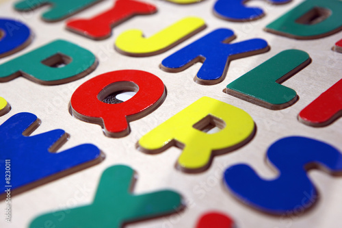 Multi-coloured capital letters of the alphabet, close-up (full frame, still life)