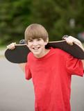 Fototapety Boy Holding His SkateBoard