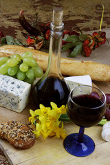 Wine, cheese, grapes and herbs