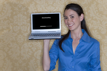 Young woman with laptop computer in hand, smiling