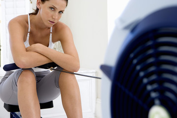 Young woman on exercise machine