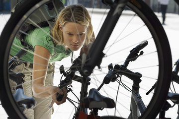Young woman shopping for new bike in bicycle shop