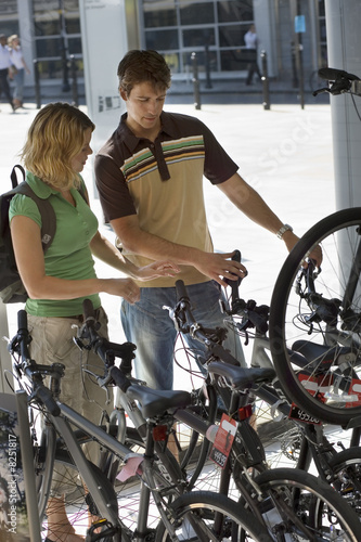Young couple shopping for new bike in bicycle shop
