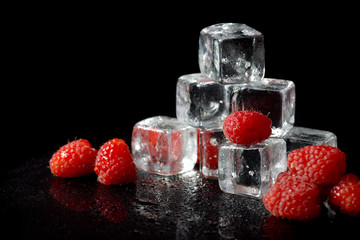 Ice cubes with raspberries