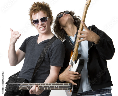 Two guys rock out with guitars