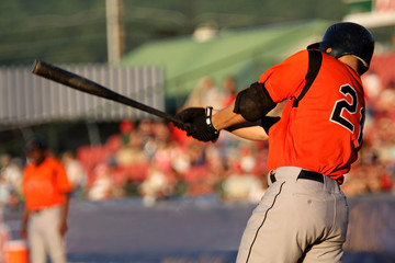 baseball batter swinging at a pitch