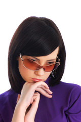 Young girl in sunglasses isolated on the white