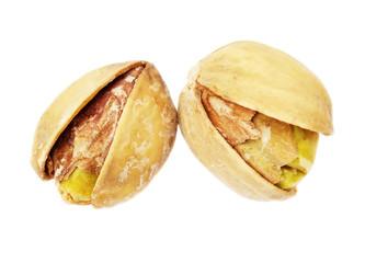 two pistachios on white background closeup