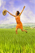 Attractive woman running through a field.