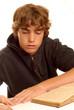 teenager doing homework isolated on white background..