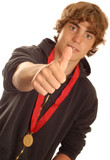 teenager wearing winning medal with thumbs