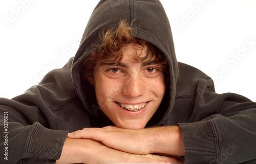happy teen boy wearing braces on his teeth
